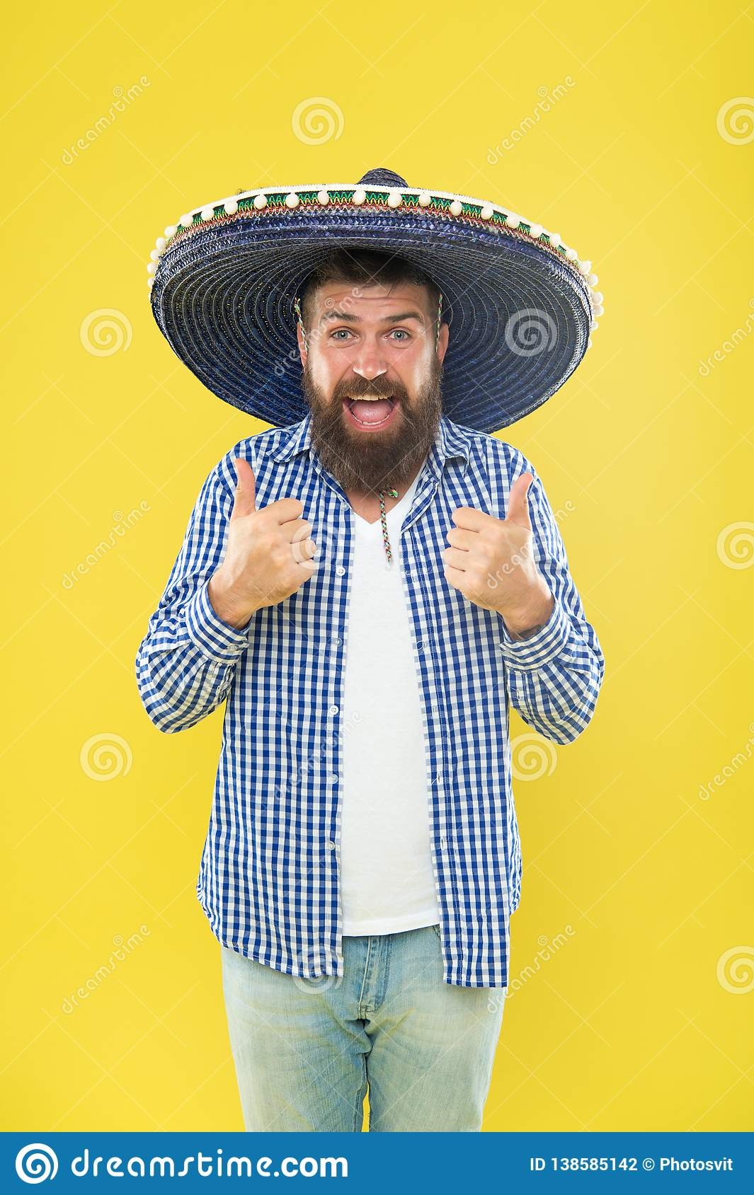 He is in love with mexican style. Mexican man wearing sombrero. Bearded man in mexican hat. Hipster in wide brim hat