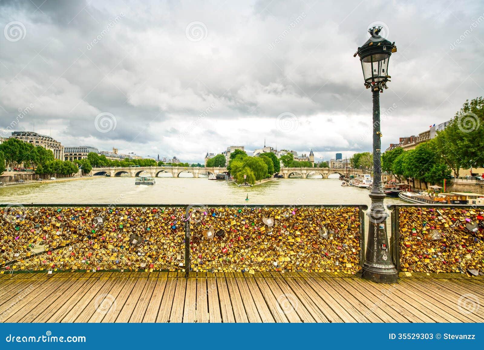 love padlocks on pont des arts bridge seine river in. Black Bedroom Furniture Sets. Home Design Ideas
