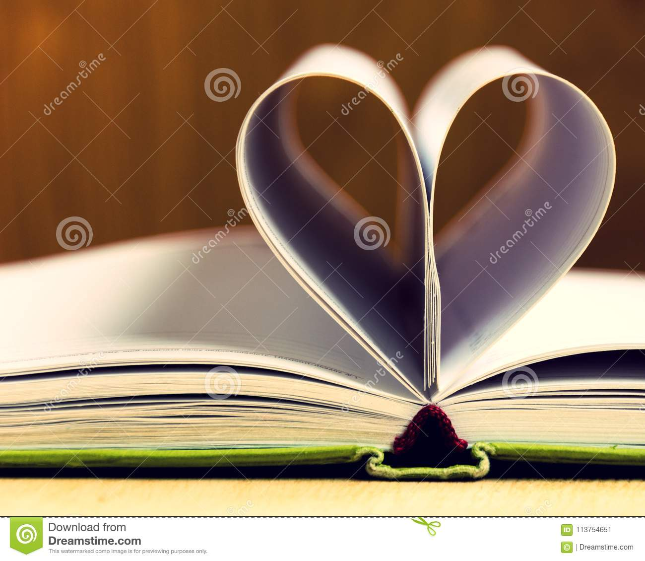 Love paper heart is made from the book`s pages empty pages of life