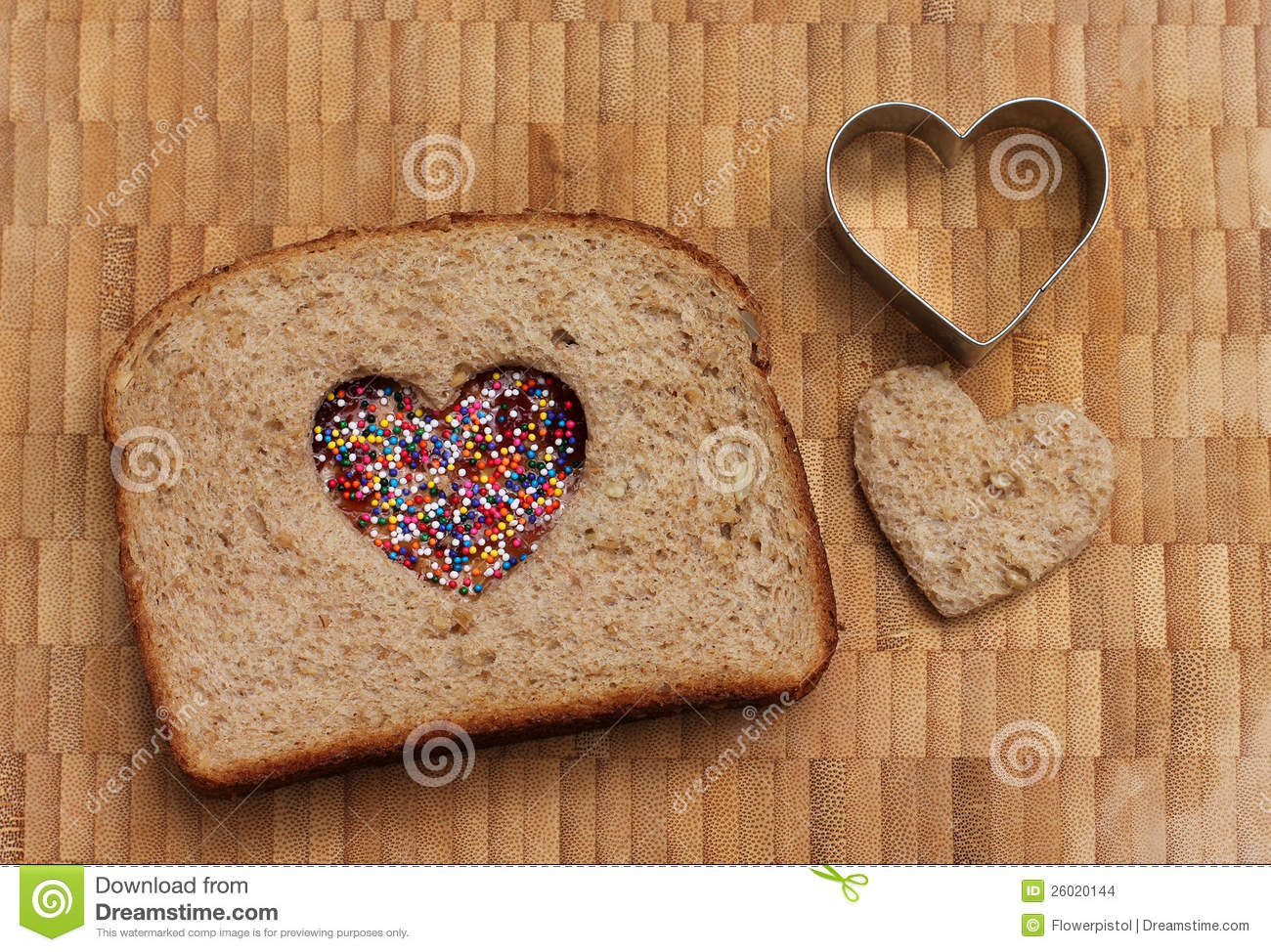 Peanut butter and jelly sandwich with a heart cut out and cute little ...