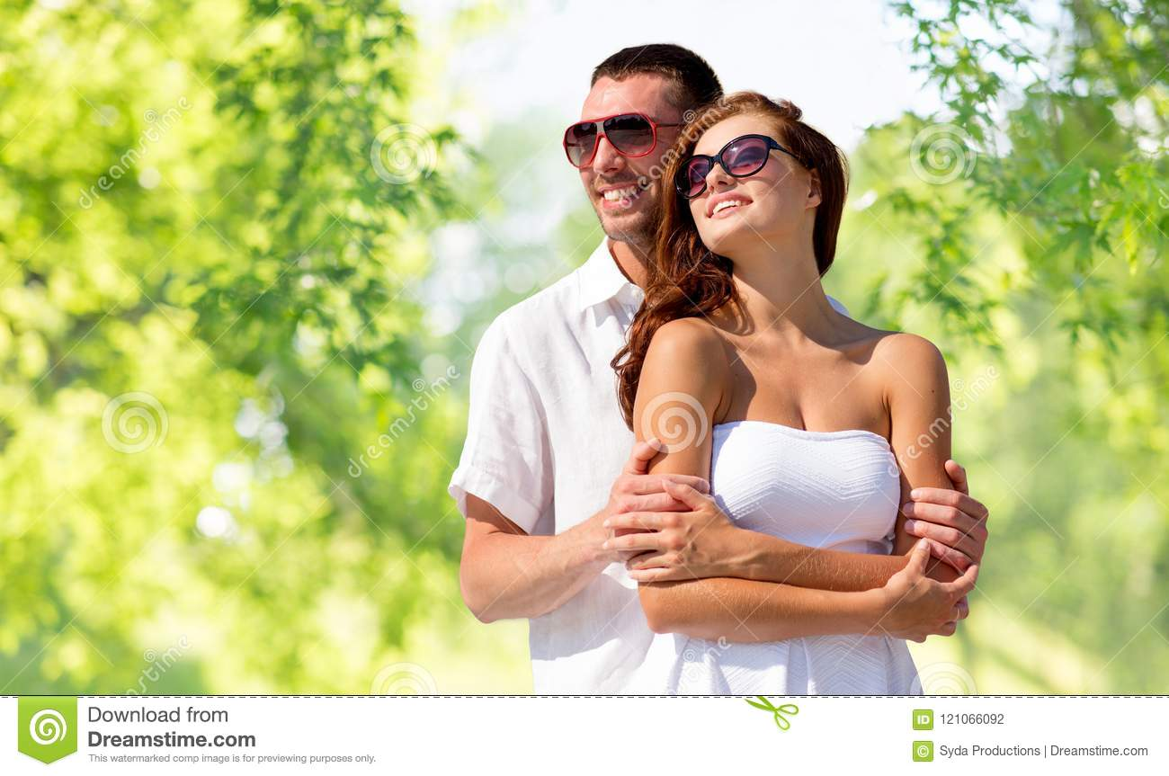 Happy smiling couple in sunglasses
