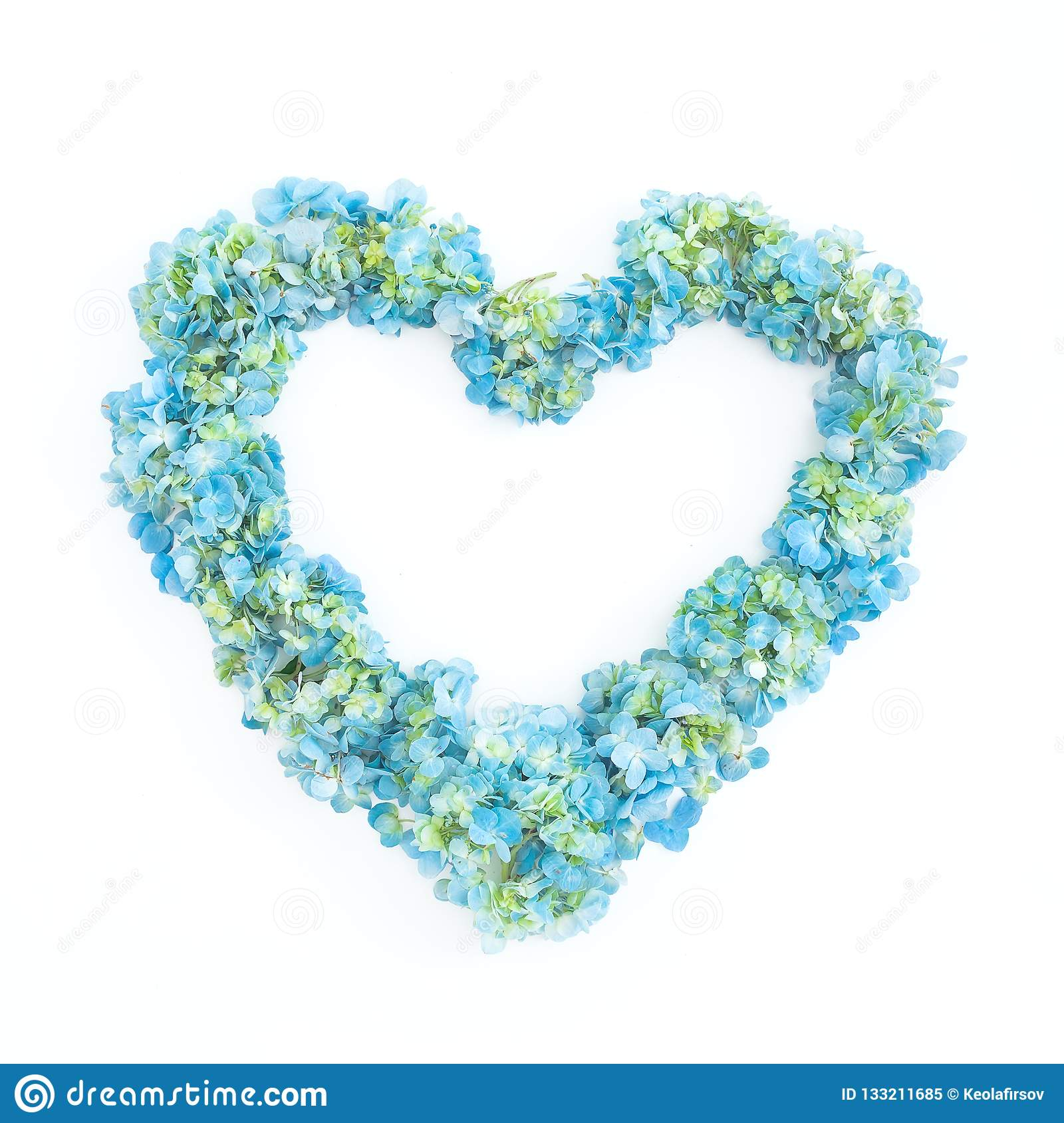Love symbol of blue hydrangea flowers on white background. Flat lay, top view