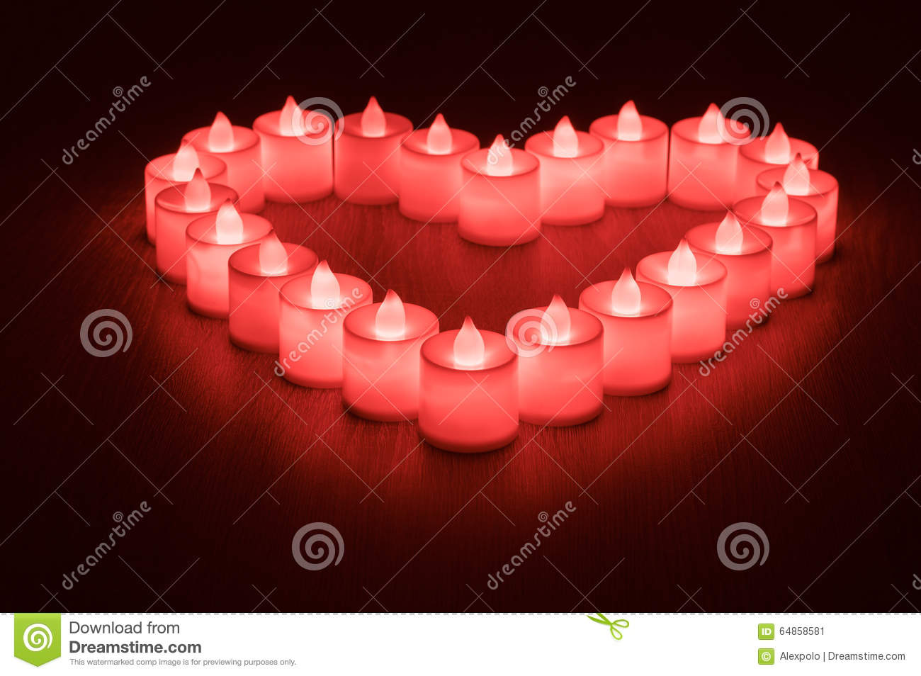 Love symbol made from many led candles