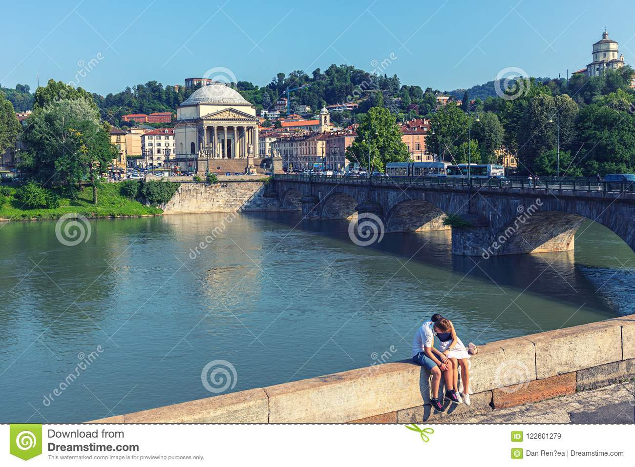 40a851c1e9 In love tourists couple relaxing on center of Torino Turin, Italy with  Vittorio Emanuele I bridge over Po river and the church of Gran Madre di  Dio, Turin, ...