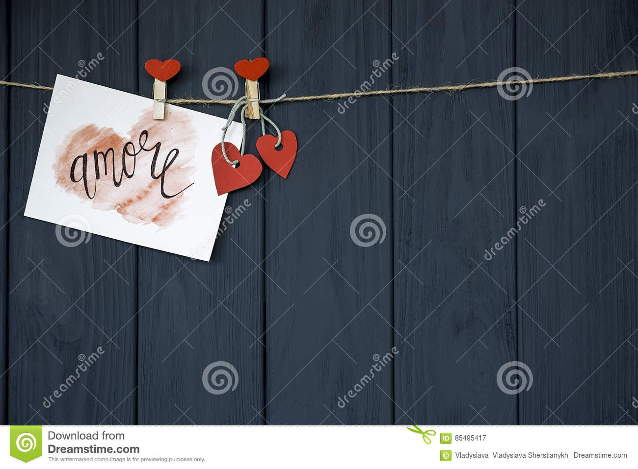 Love Valentine`s card `Amore` natural cord and red pins hanging on rustic Driftwood texture background, Copy Sp