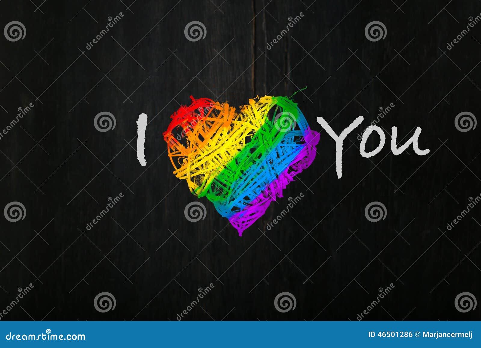 Love Valentines heart wreath in rainbow pride colours dark background