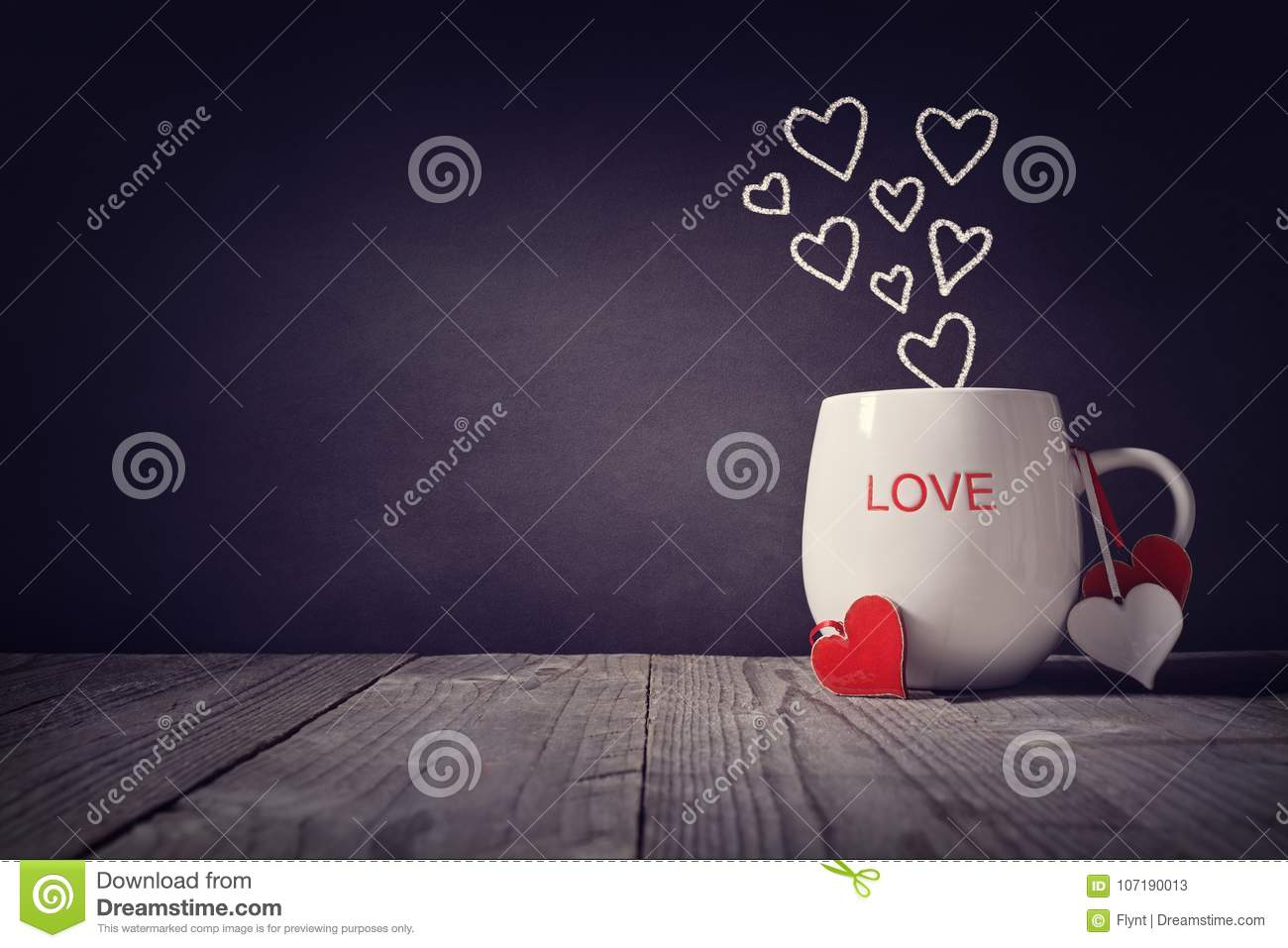 Love written on a mug concept for Valentines day or Mothers day