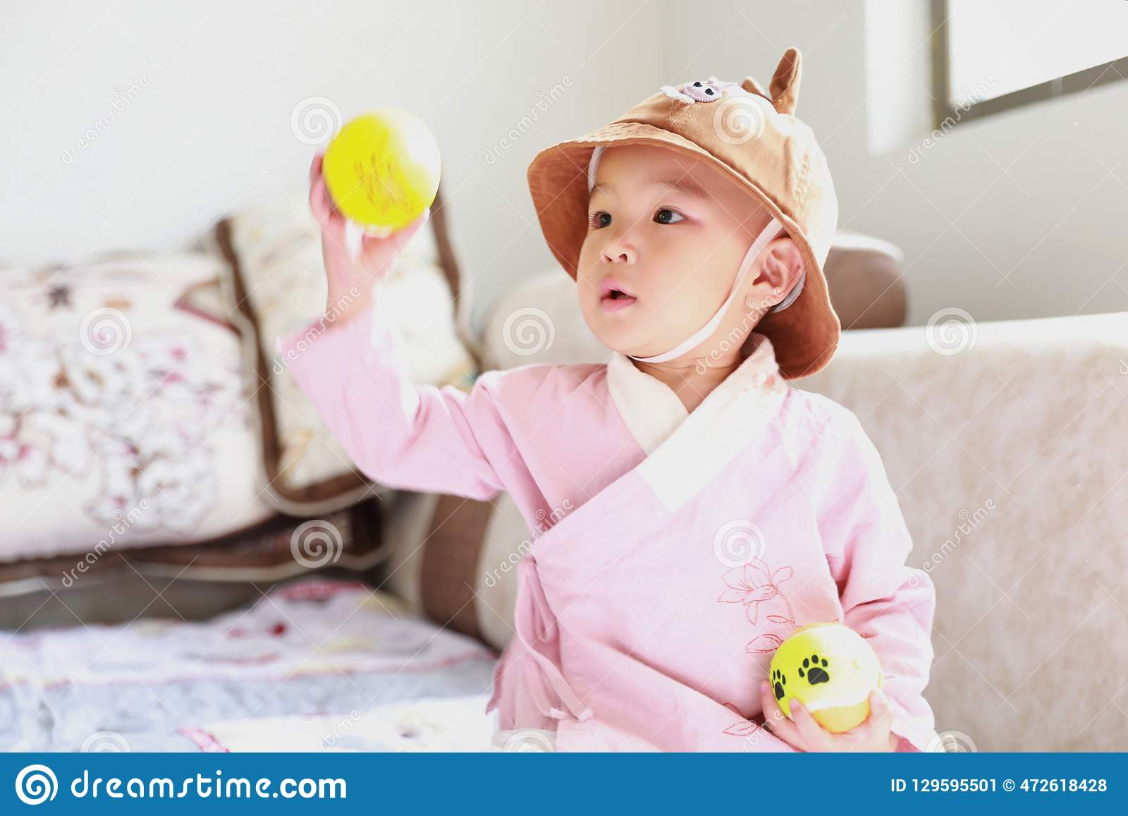 Lovely Baby girl With a hat play on sofa