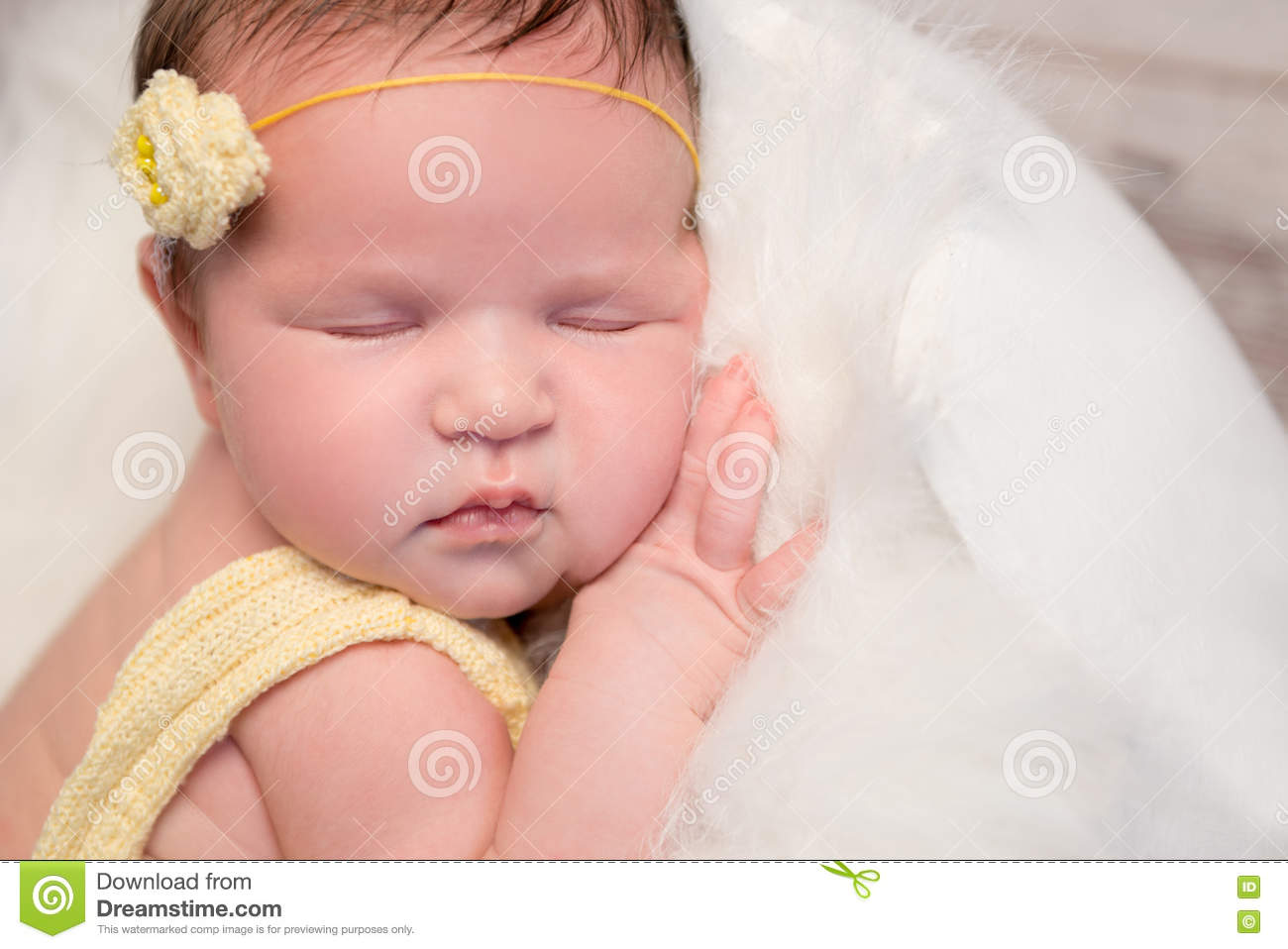 99521cb5b Lovely Baby In Yellow Romper Sleeping With Legs Crossed Stock Photo ...