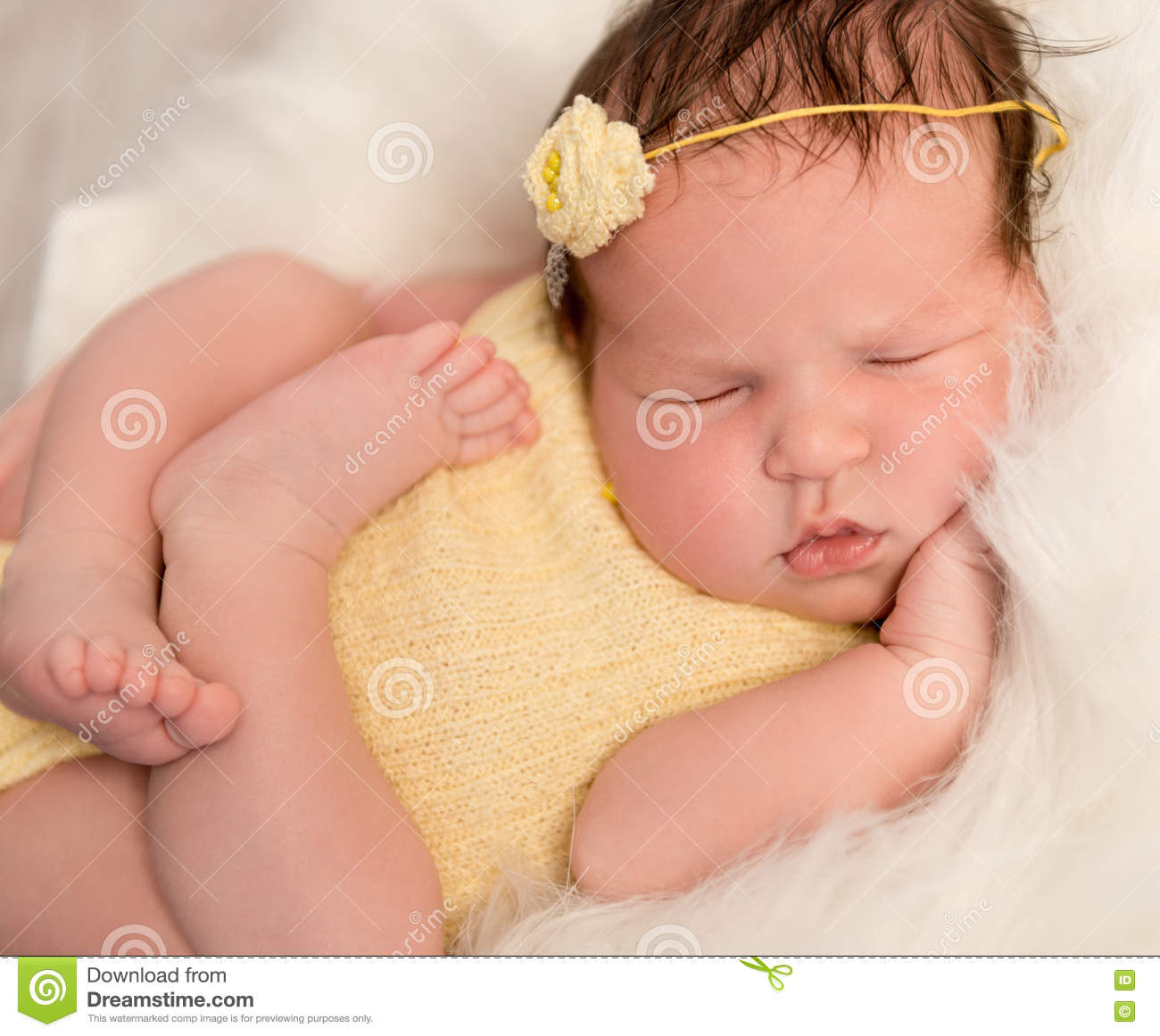 5f769d1de Lovely Baby In Yellow Romper Sleeping With Legs Crossed Stock Image ...