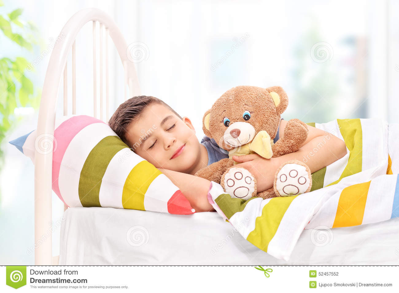Lovely Boy Sleeping With A Teddy Bear In A Bed Stock Photo