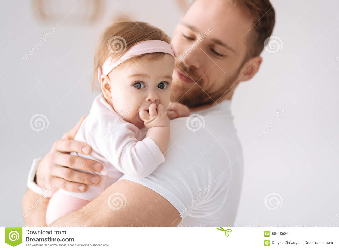 Lovely child expressing emotions with the father