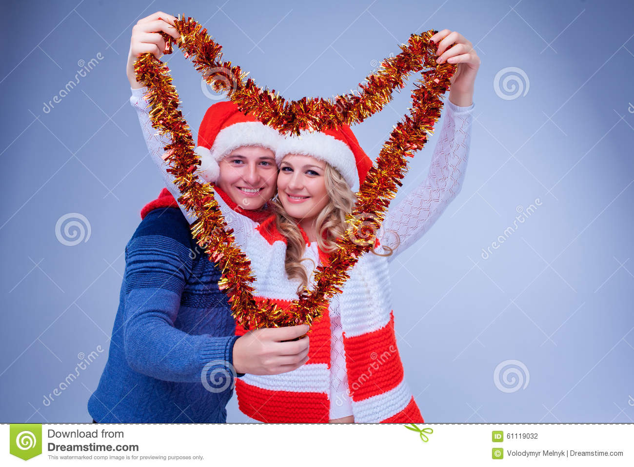 Lovely couple with christmas garland stock photo image