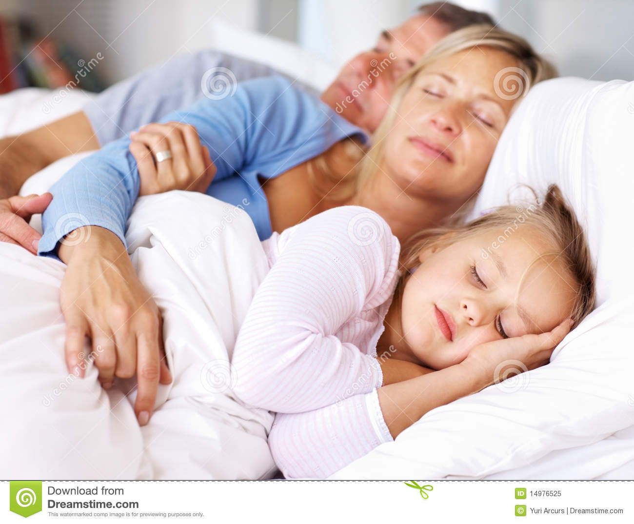Lovely Family Sleeping Together On Bed Stock Image Image
