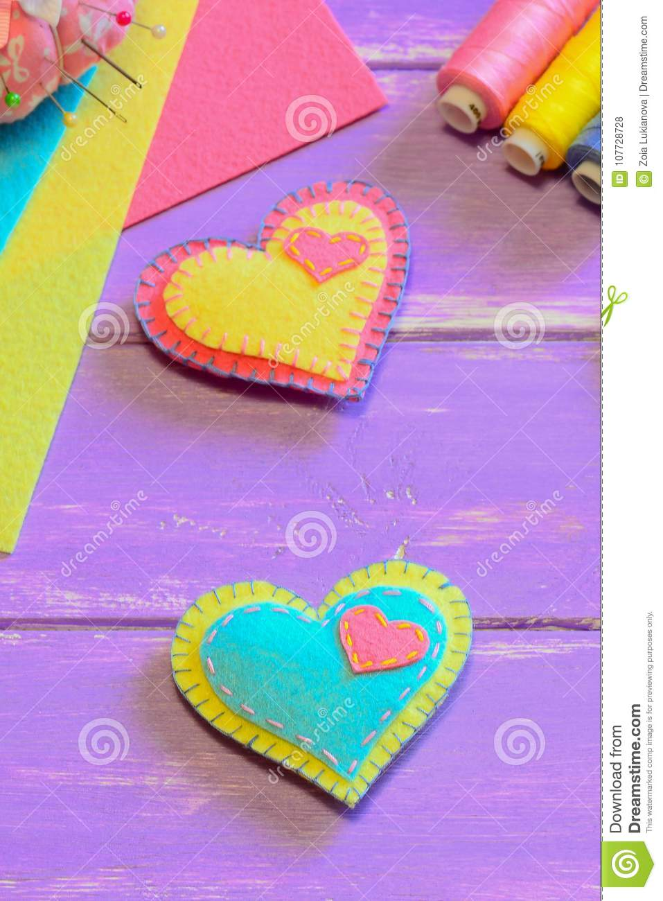 Lovely felt hearts. Valentines Day symbols. Cute homemade Valentines day gifts. Simple hand sewing project for kids. Vertical phot