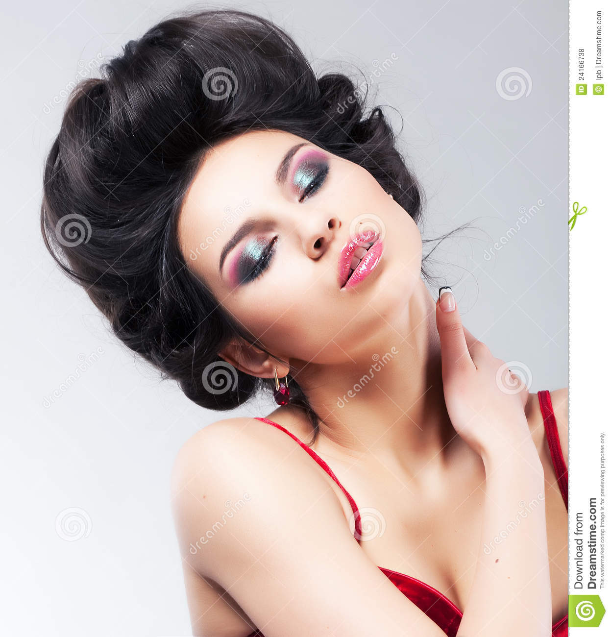 Lovely female with rerto hairstyle - studio shot