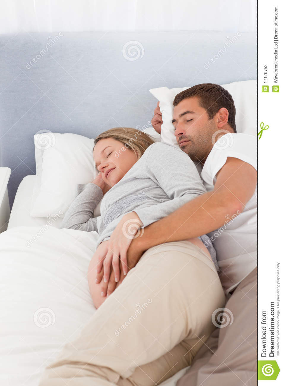 Baby Sleeping In Bedroom With Parents: Lovely Future Parents Sleeping In The Bedroom Stock