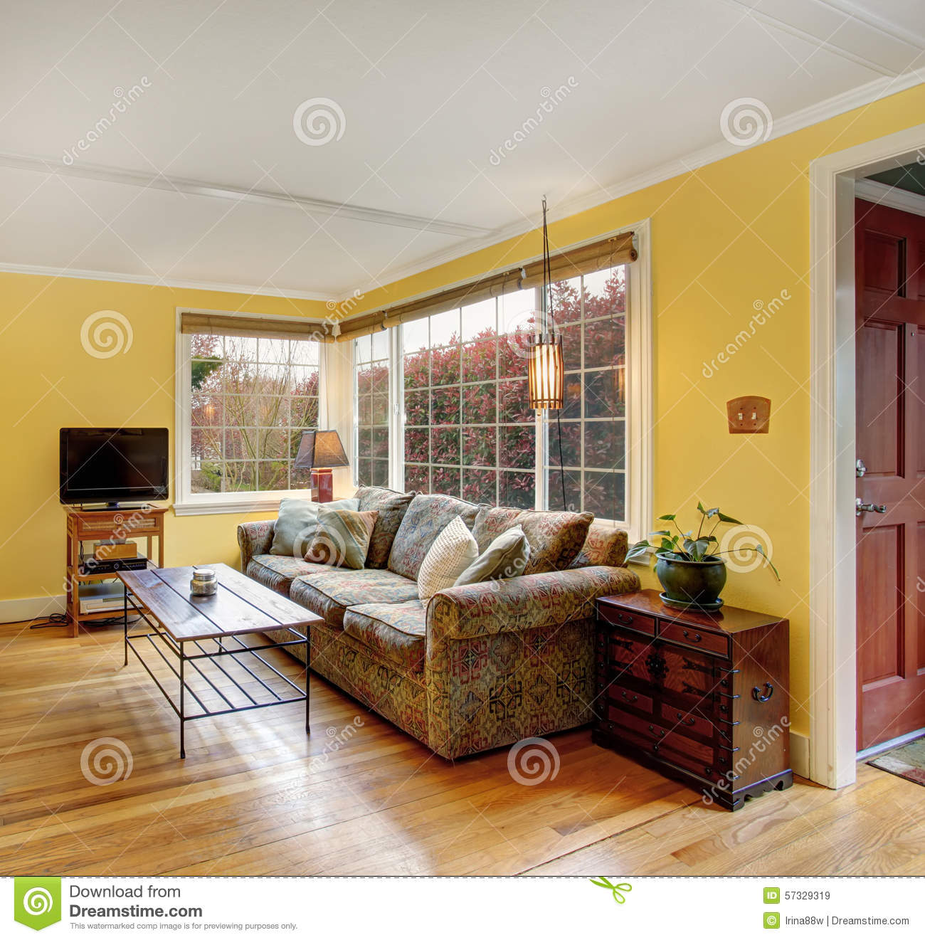 Lovely Hardwood Living Room With Colorful Sofa And Yellow