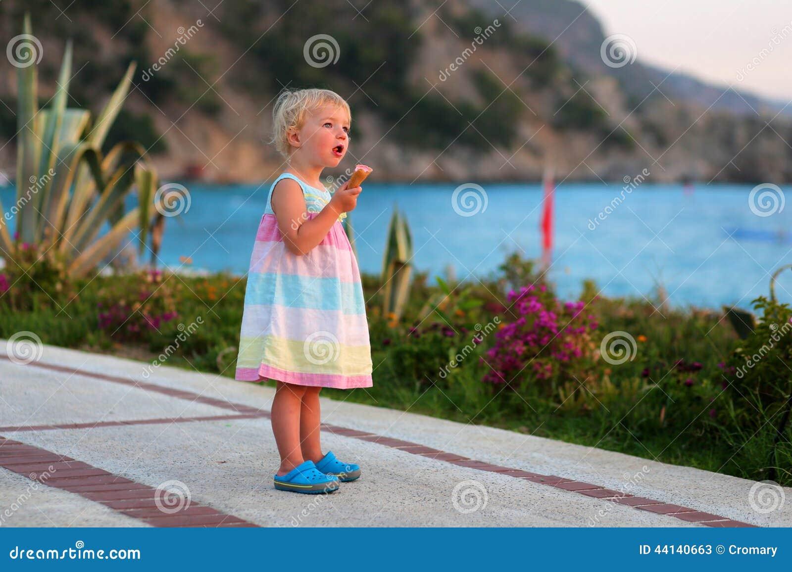 Teen Boy Eating Icecream At The Beach Stock Photo - Image