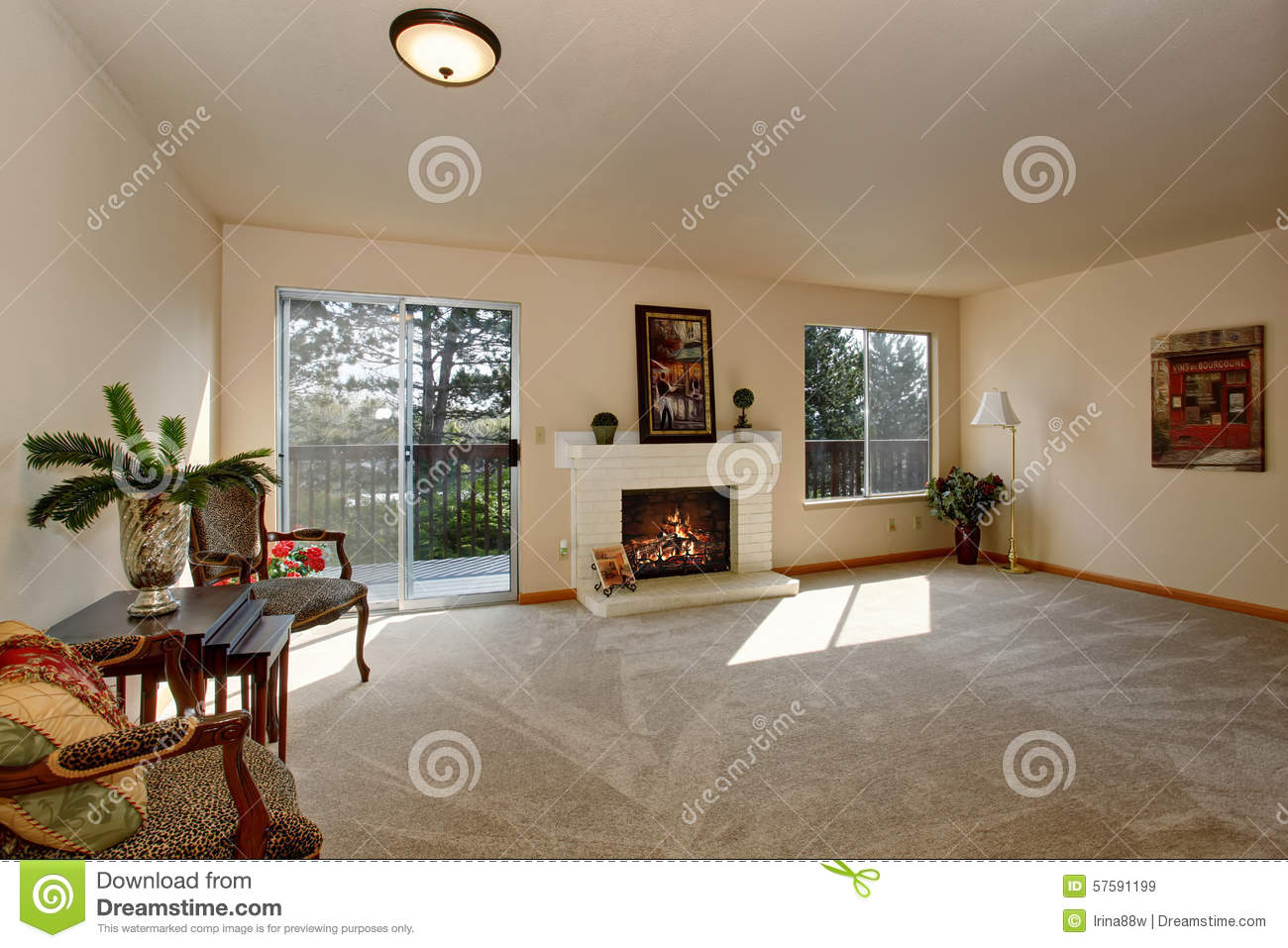 Lovely Living Room With Fireplace And Sliding Glass Door Stock