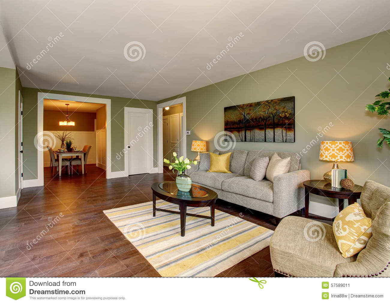 Lovely Living Room With Green And Yellow Theme Stock
