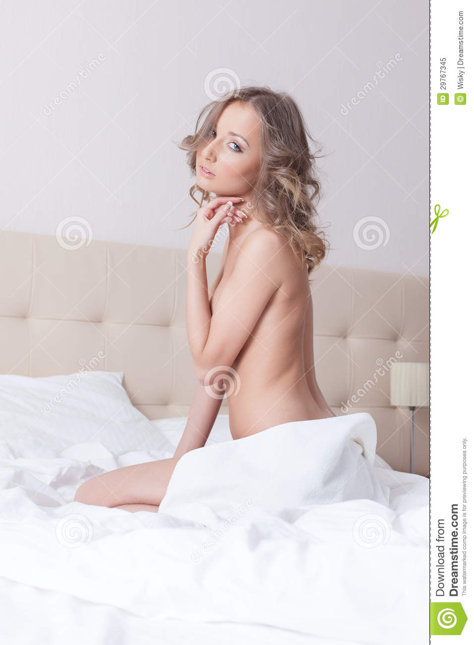 girls nude sitting on bed