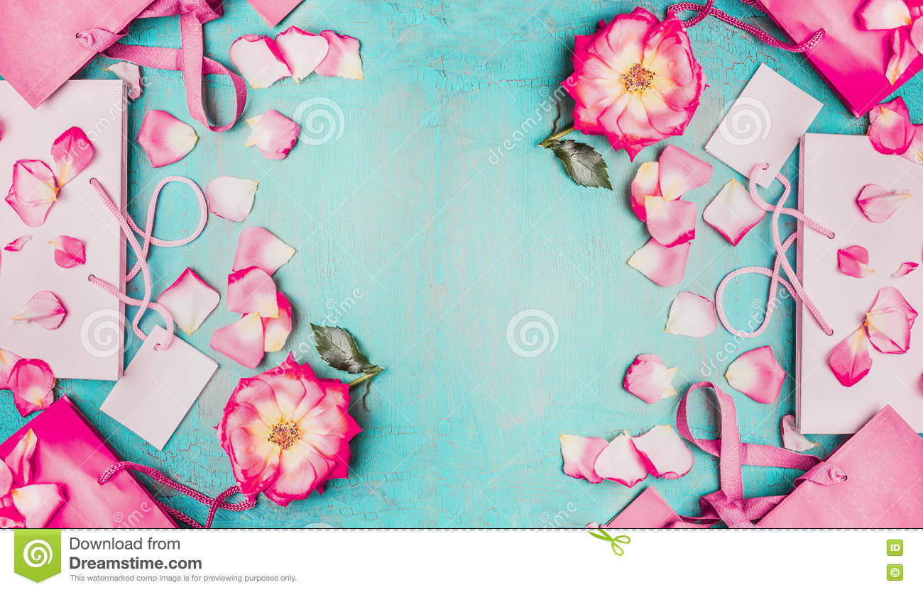 Lovely pink flowers with petals and pink paper shopping bags on lovely pink flowers with petals and pink paper shopping bags on light blue background top mightylinksfo