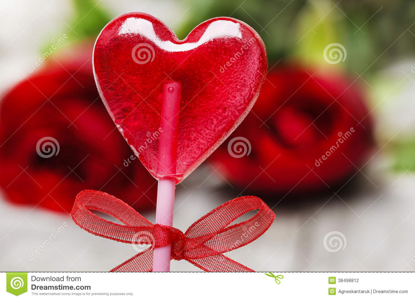 Lovely Red Lollipop In Heart Shape Symbol Of Sweet Love Stock Photo