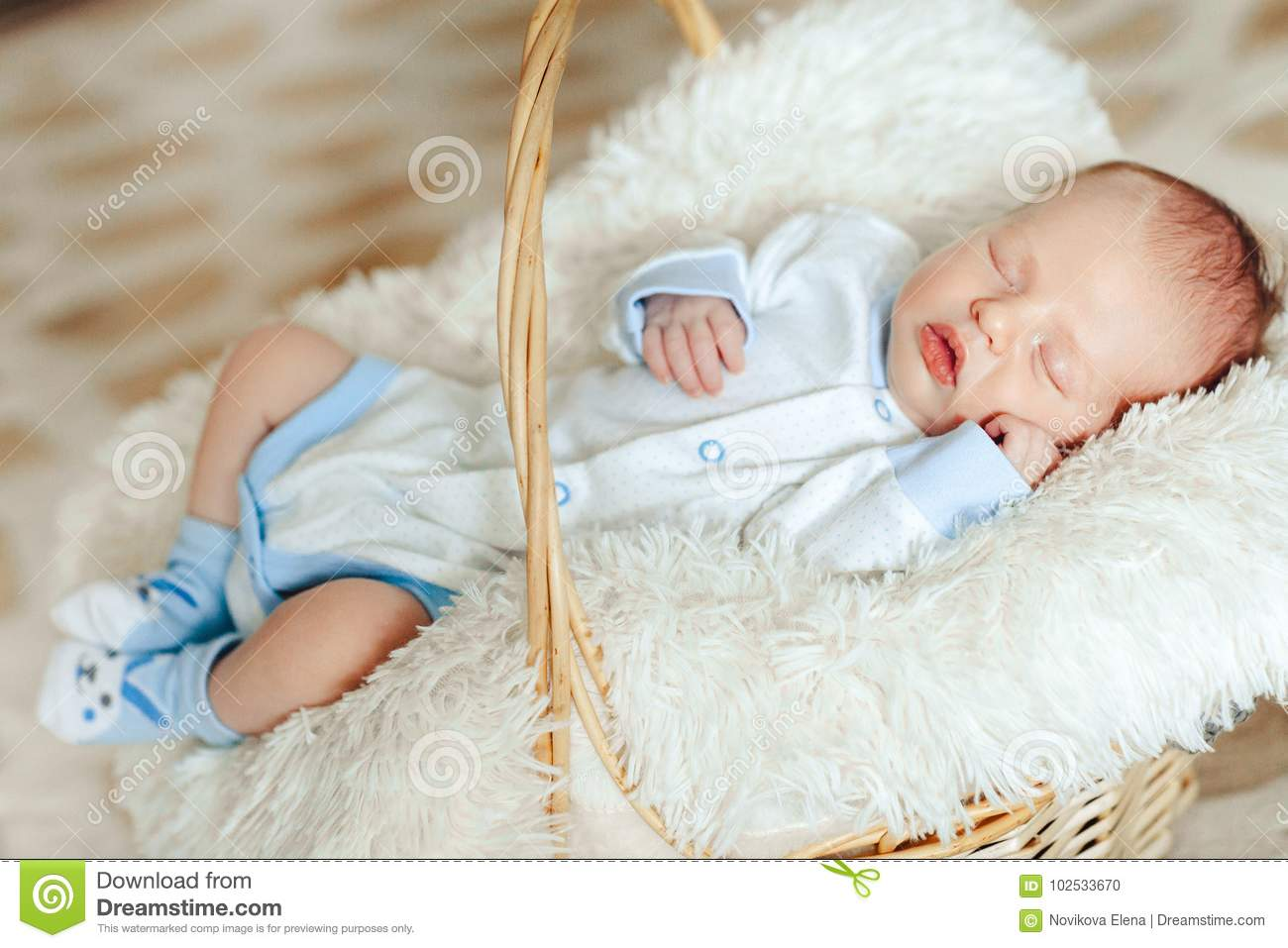 cb63b44d1 Lovely Sleeping Newborn Boy Is Dressed In Overalls And Booties Lies ...