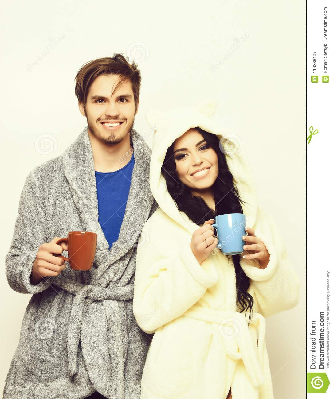 Lovely smiling happy couple holding cups
