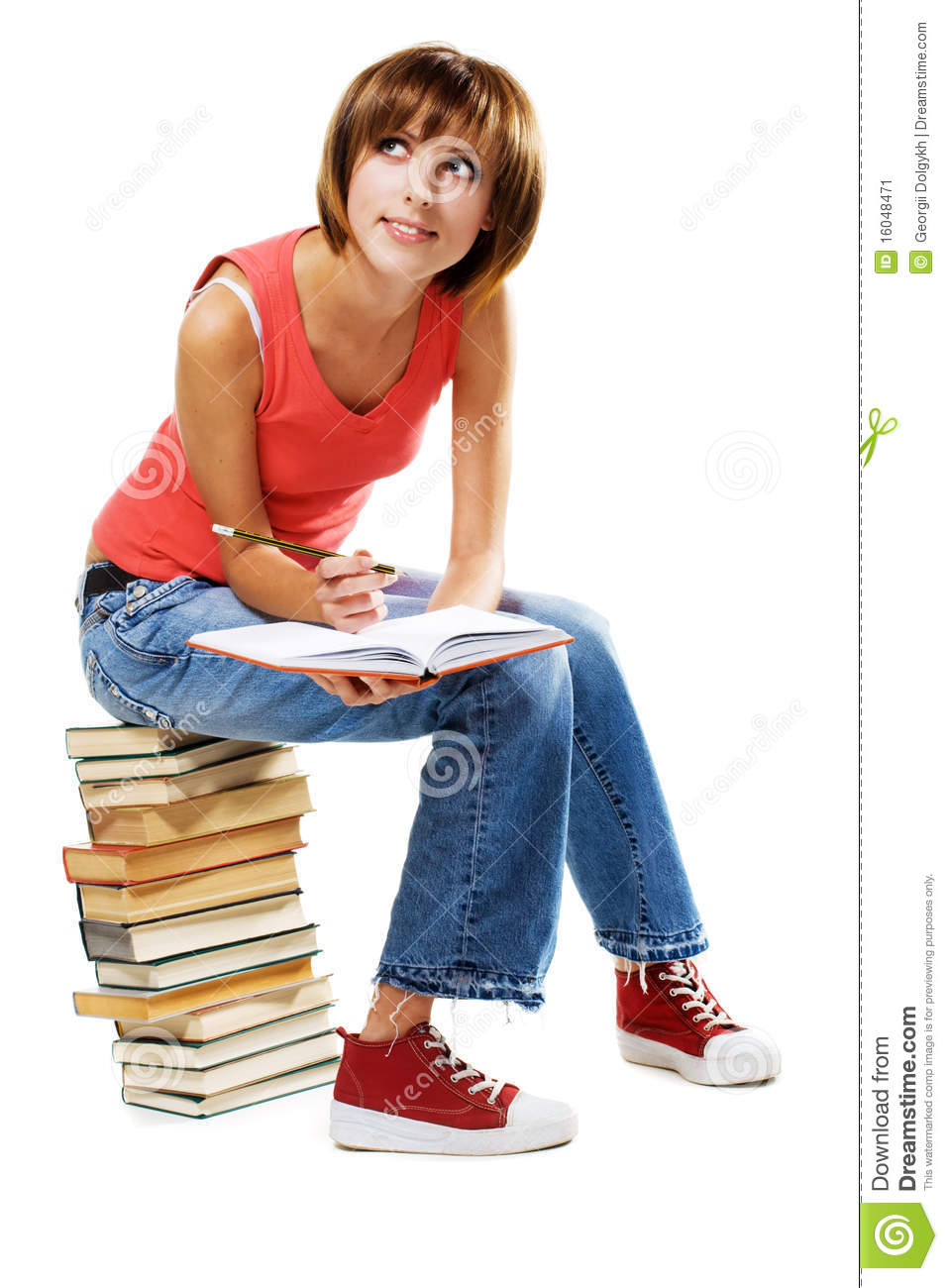 Lovely student with a lot of books