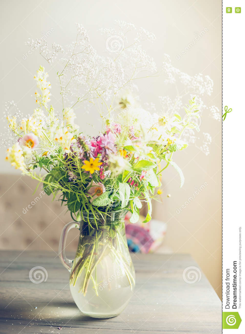 Lovely summer flowers Bouquet on table in light living room. Home