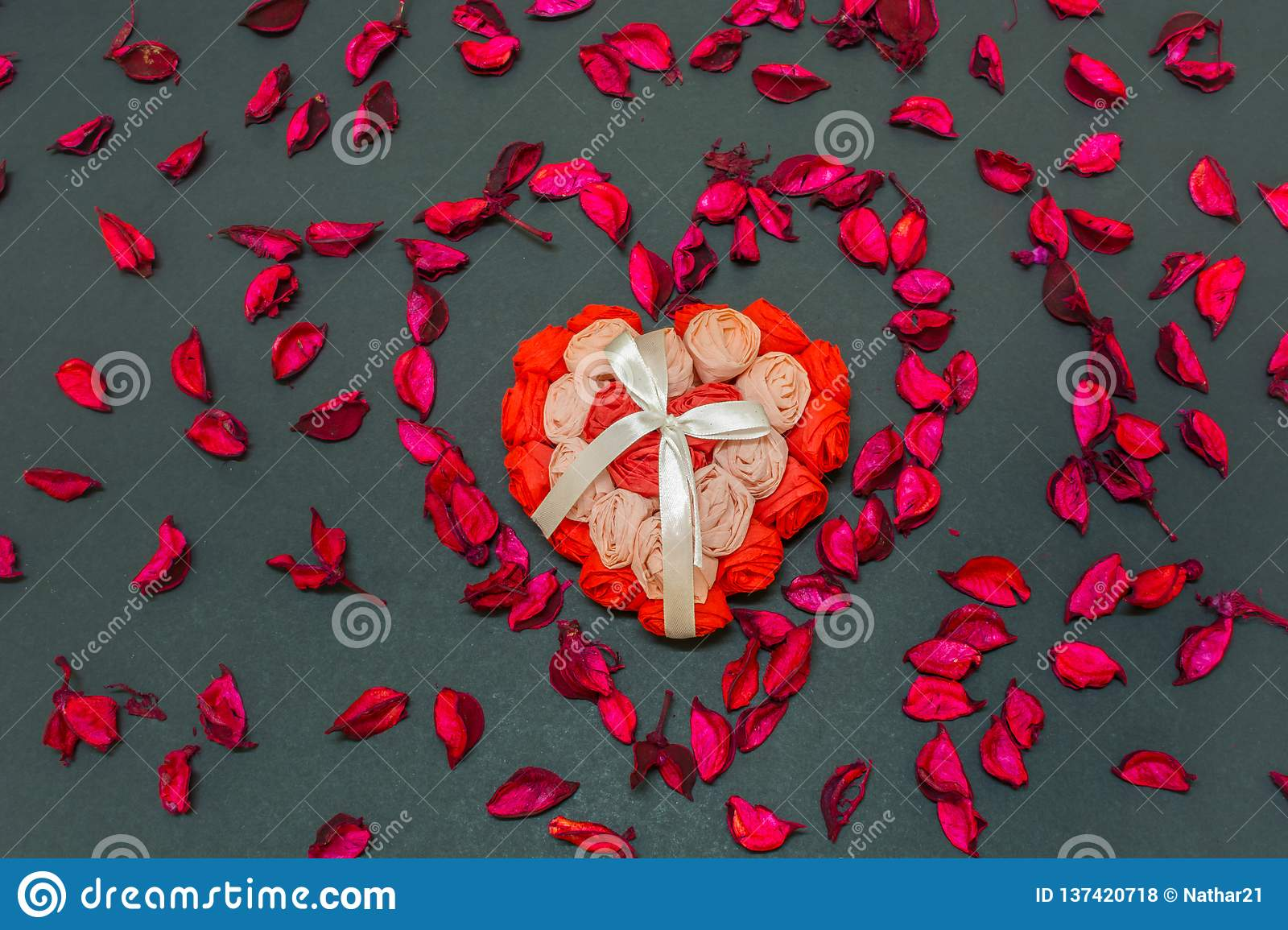 Lovely Valentines Day Gift for the love of life in the centre of heart shaped rose petals
