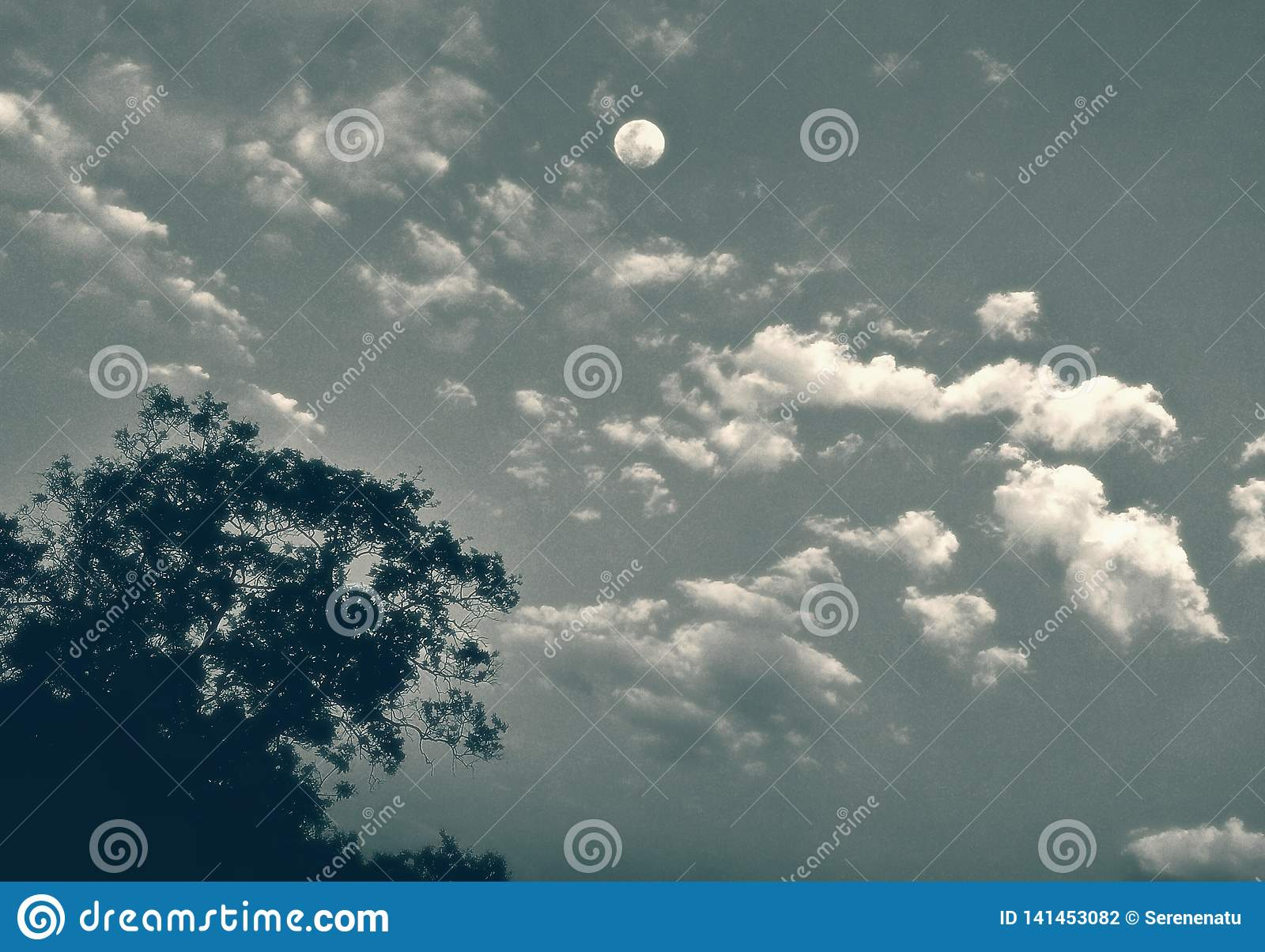 A view of moon in the clouds with an artistic touch