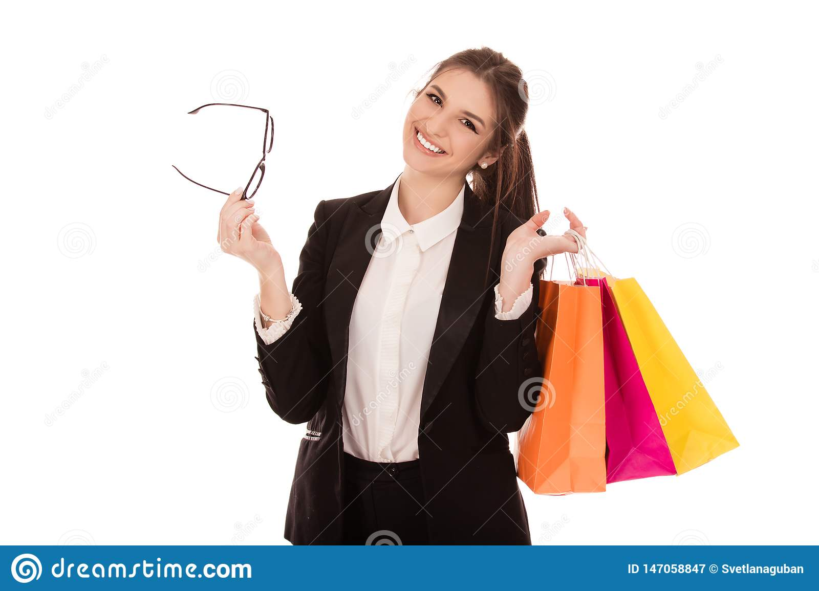 Lovely woman holding shopping bags and eye glasses