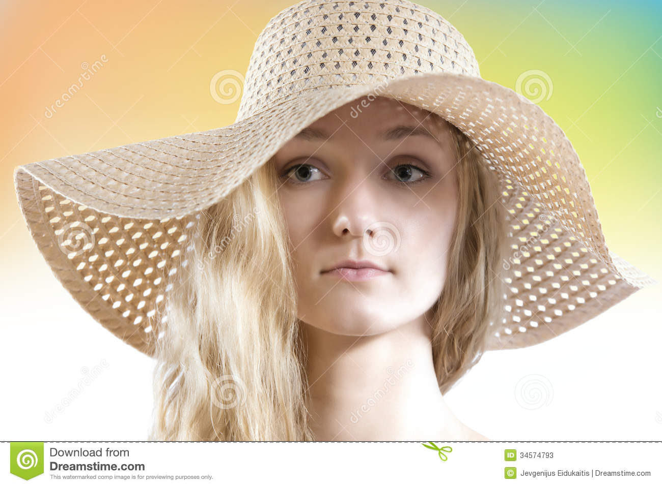 Lovely woman with no make up wearing straw summer hat