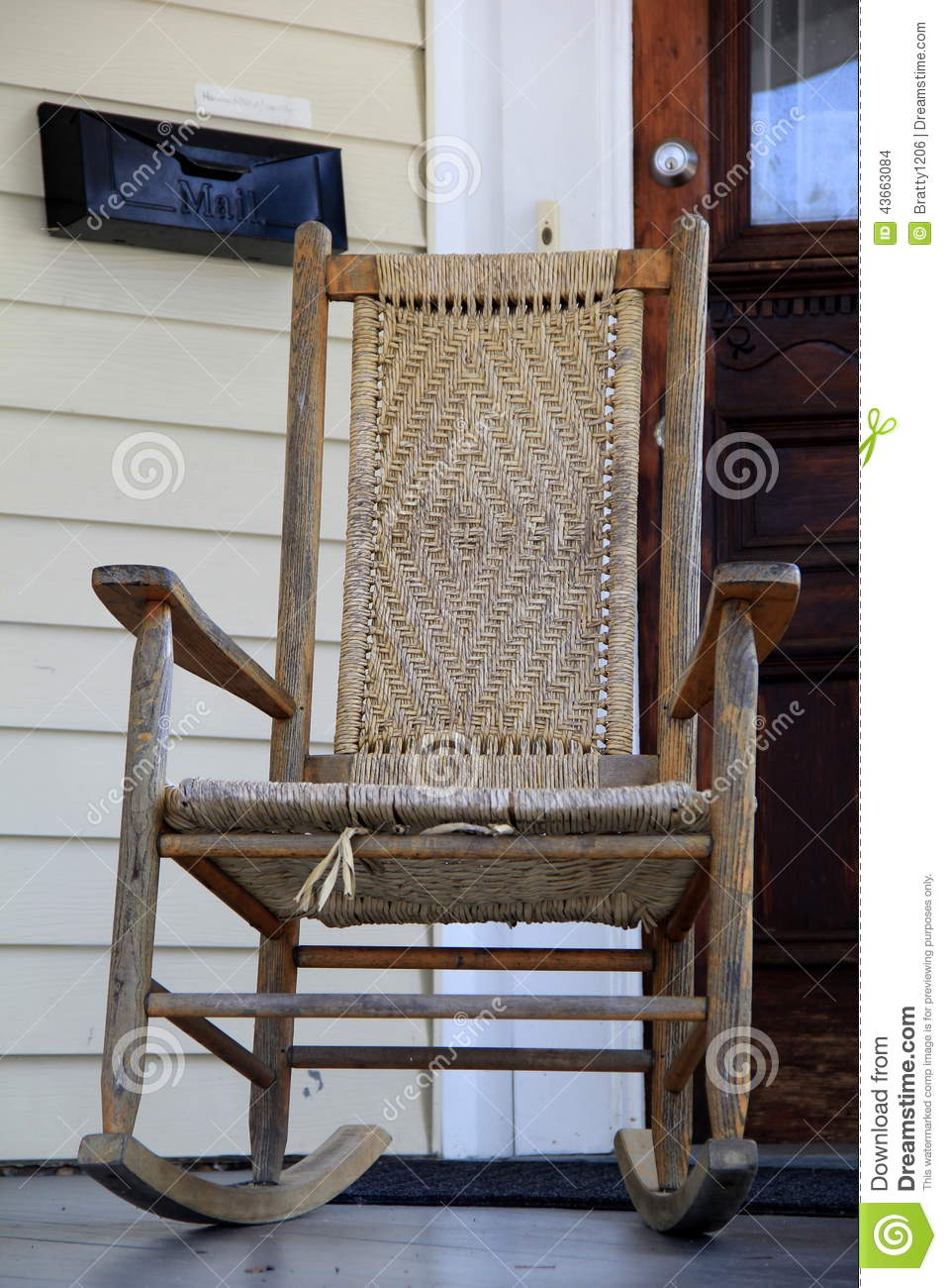 Awesome Lovely Wood Rocking Chair On Front Porch Stock Photo Image Ibusinesslaw Wood Chair Design Ideas Ibusinesslaworg