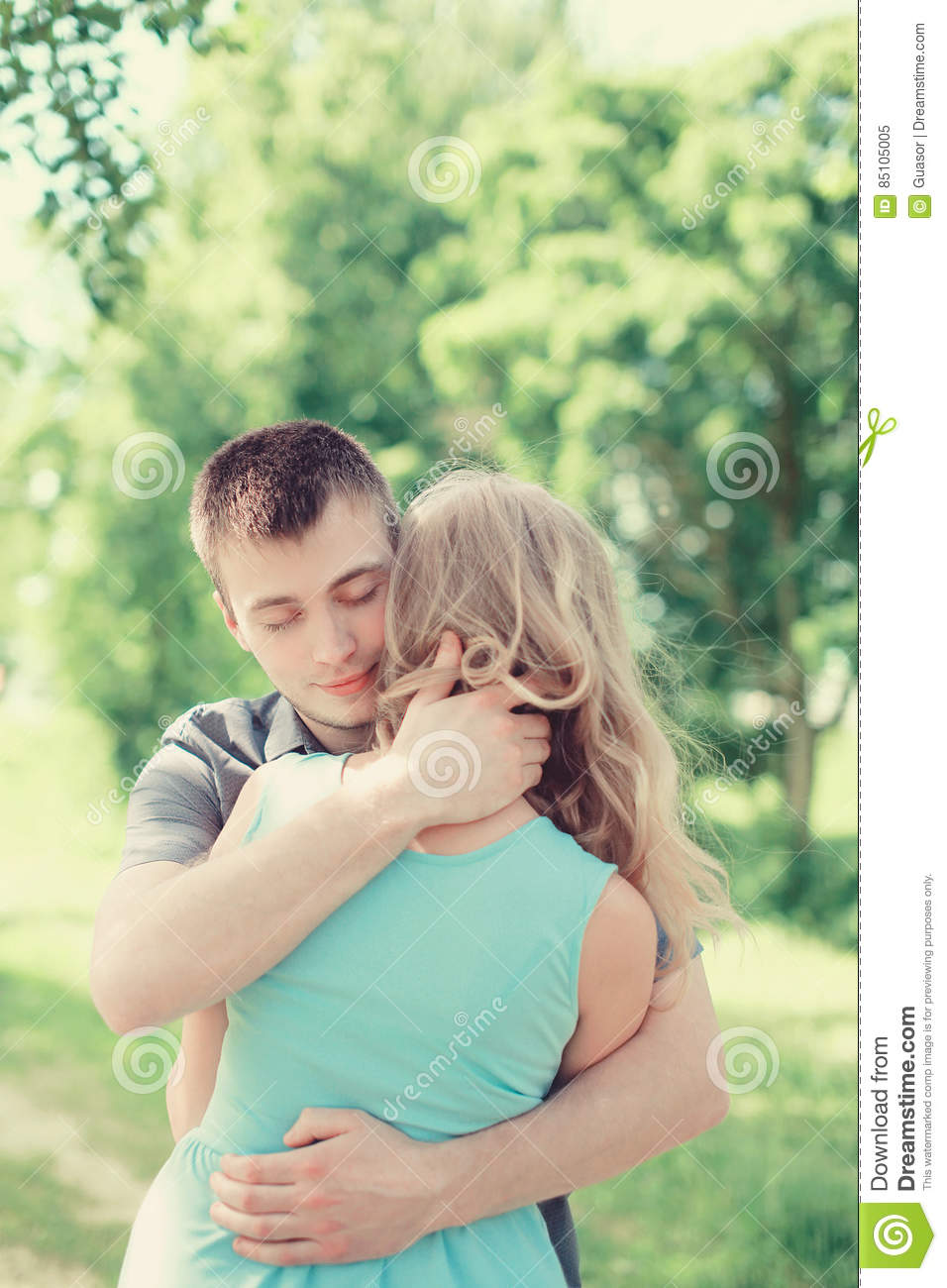 Lovely young couple in love, man embracing woman, warm feelings