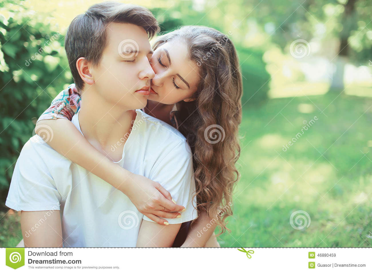 Lovely young couple teenagers in love
