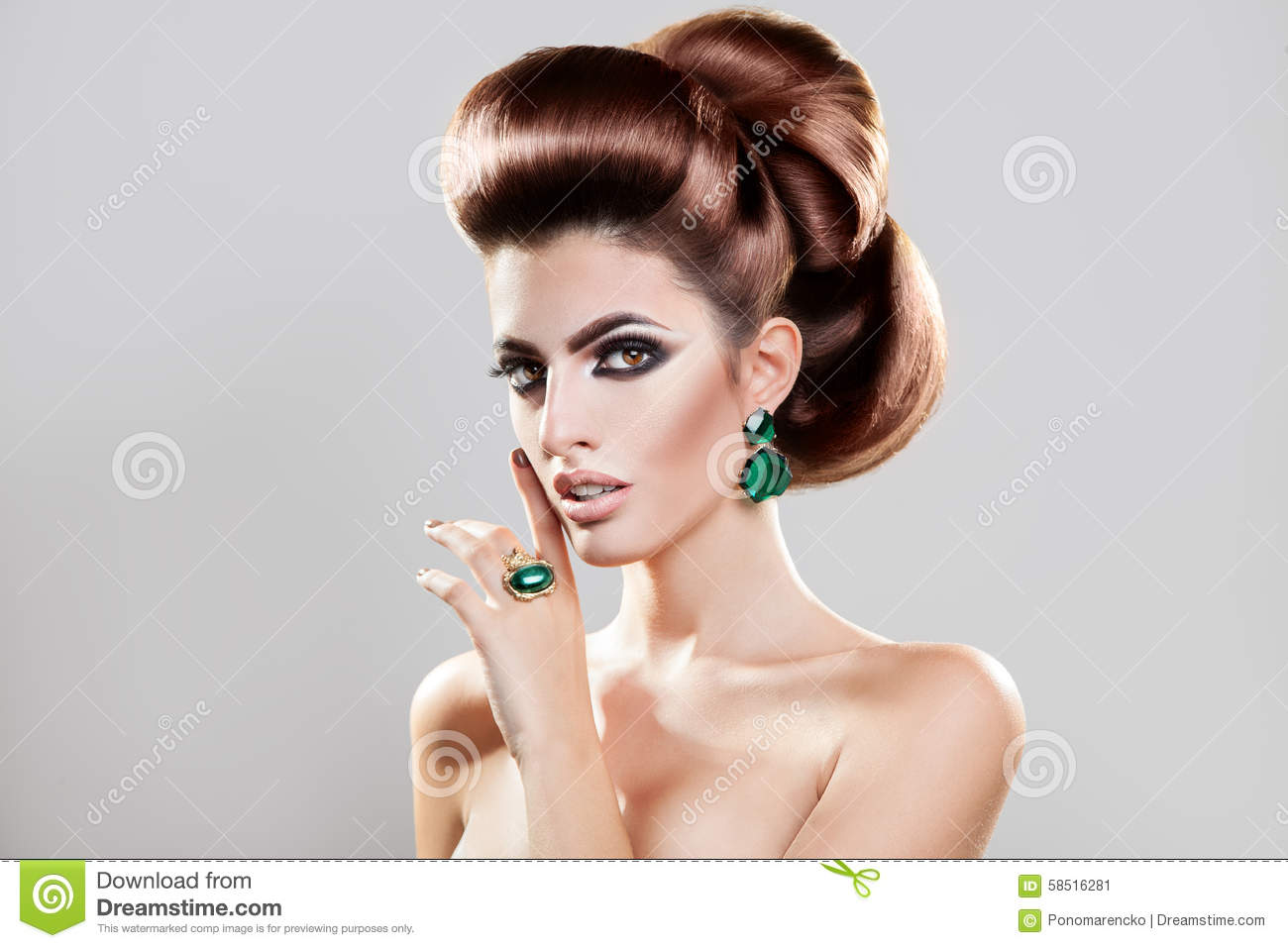 Lovely young girl with creative brown hairstyle and professional