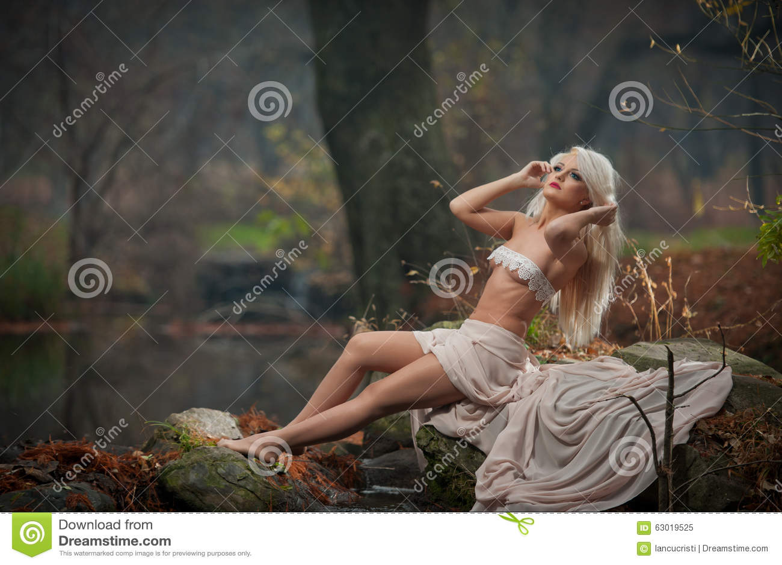 Very sensual lady in woods