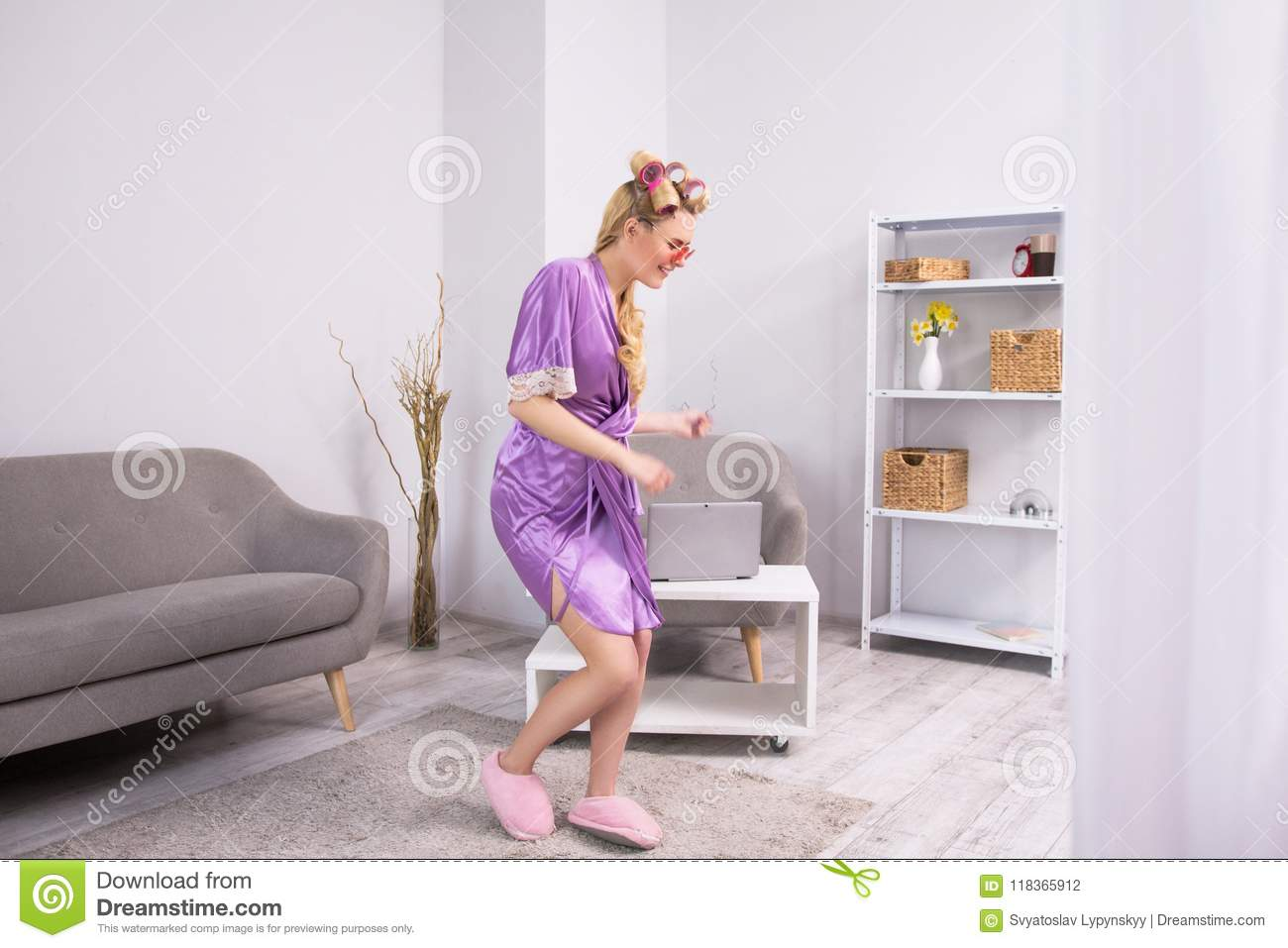 Girl dancing in living room.