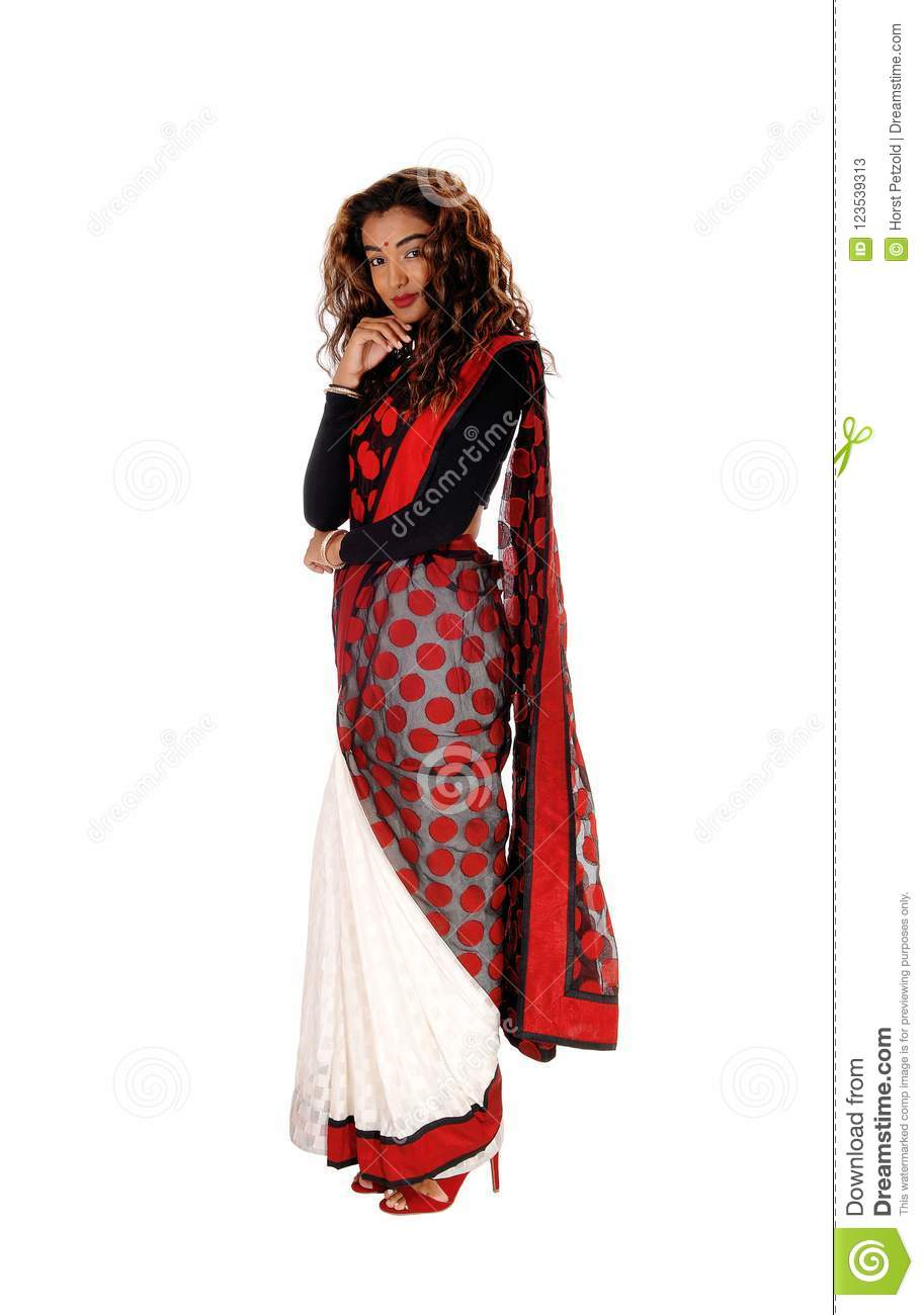 f5a89048ba A beautiful tall woman in a colorful East Indian saree with long curly  brunette hair standing in profile, isolated for white background