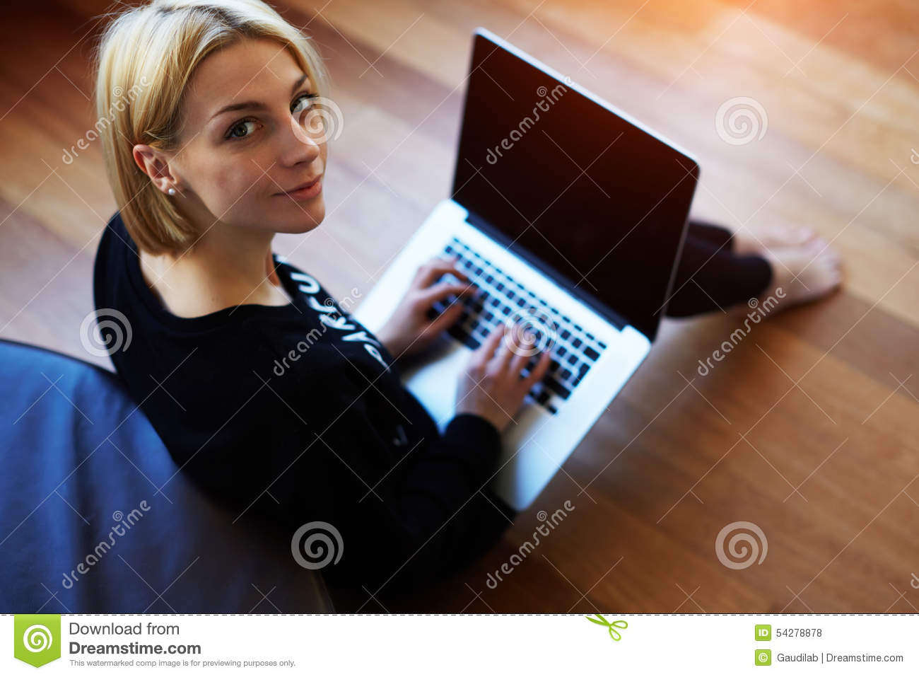 Lovely young woman working on laptop computer at home