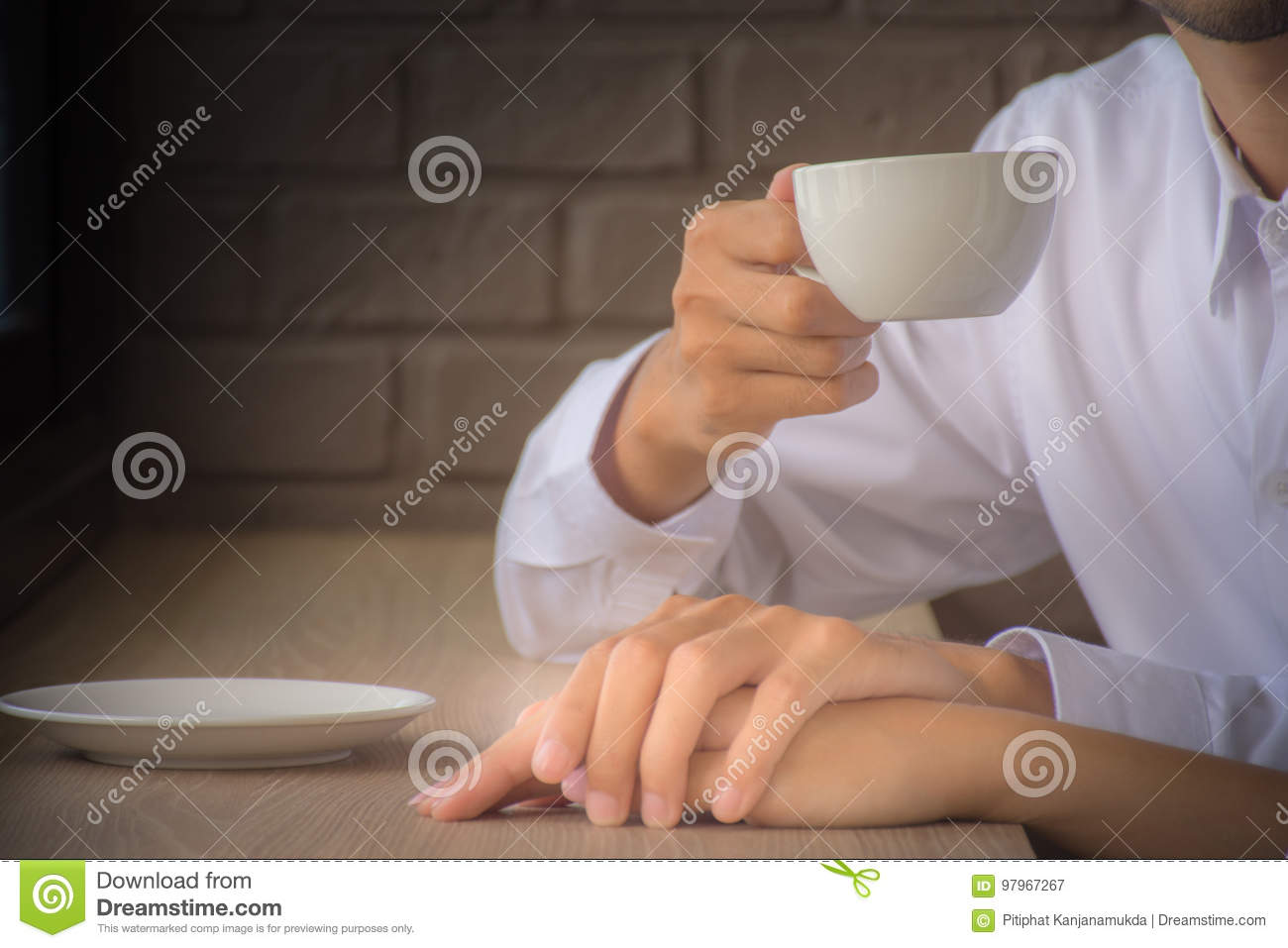Lovers are drinking coffee While holding hands