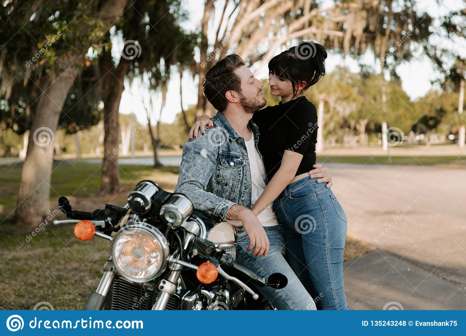 Loving Adorable Portrait of two Attractive Good Looking Young Adult Modern Fashionable People Guy Girl Couple Kissing and Hugging