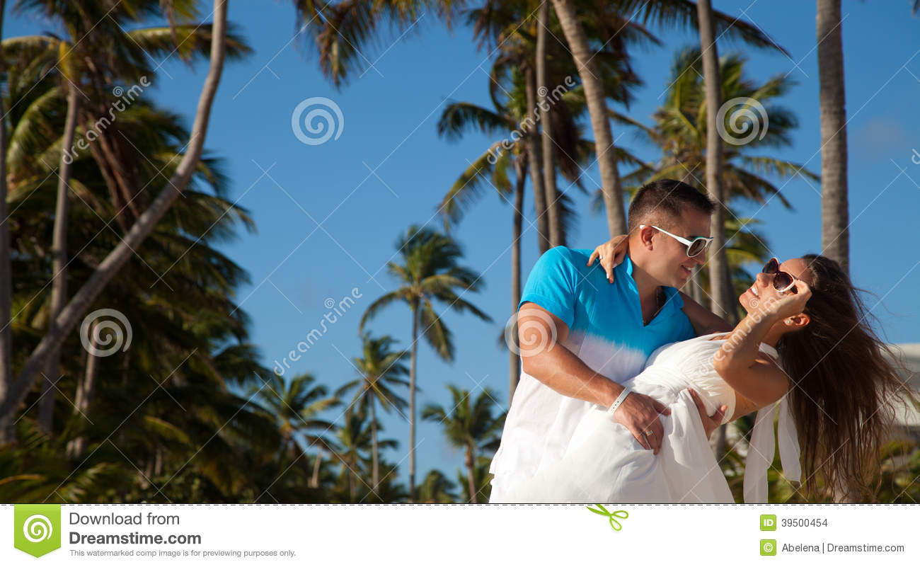 Loving couple - beach at summer - the romantic date or wedding o