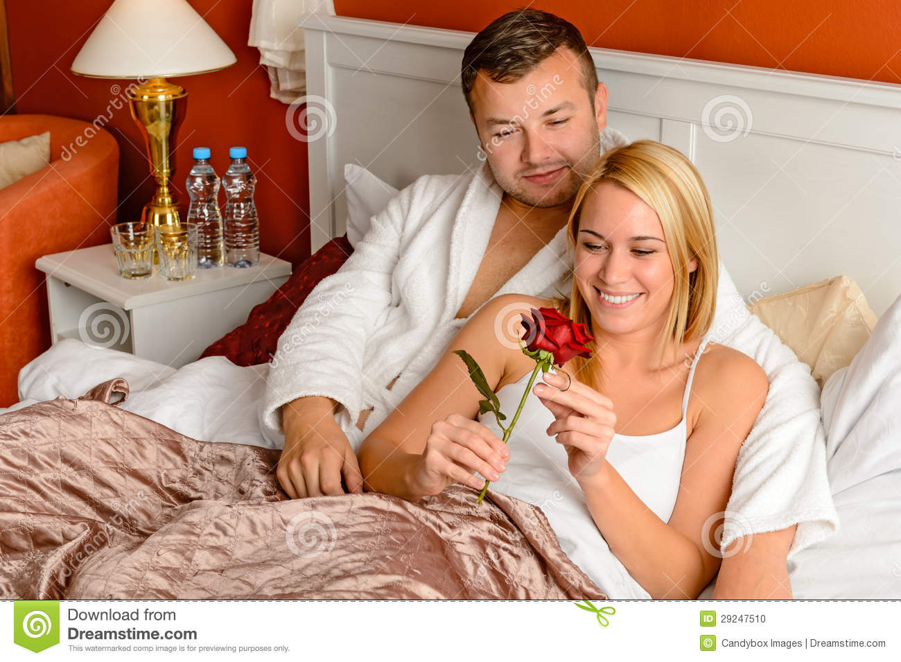 Loving couple celebrating romantic anniversary rose bed stock