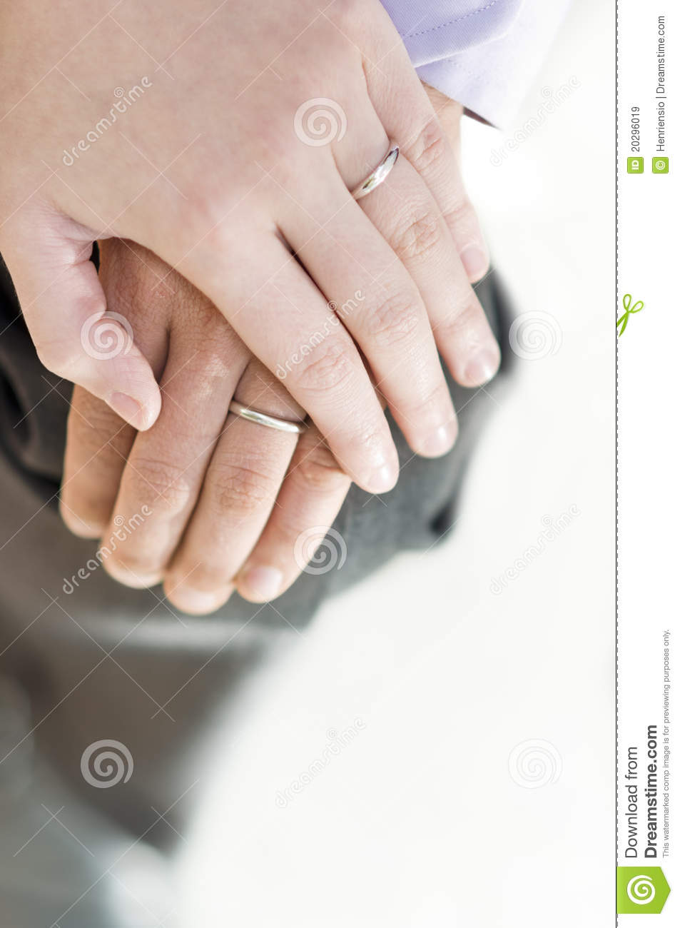 Loving Couple Holding Ring Hands On The Knee Stock Image