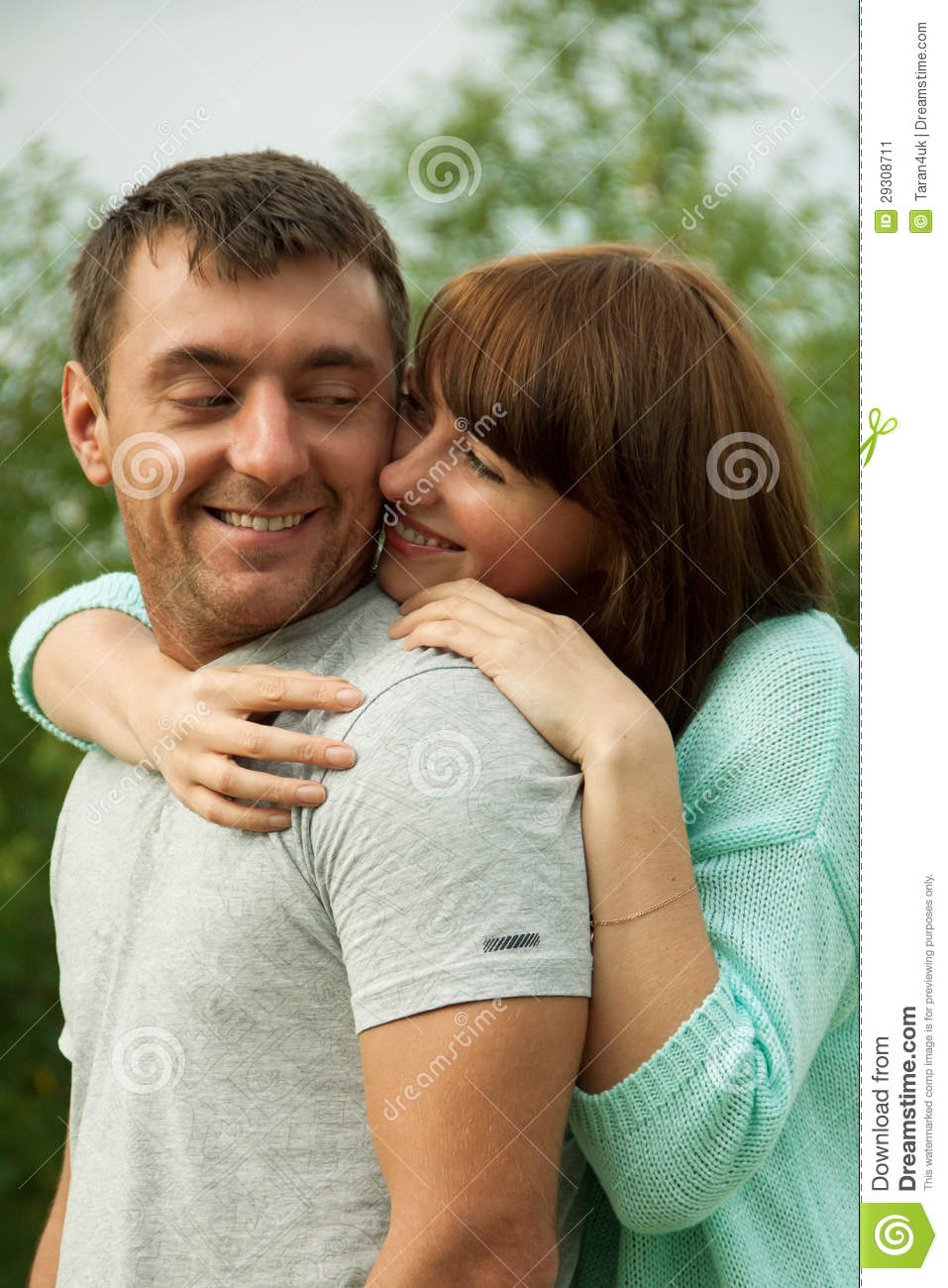 loving couple hugging each other and having fun stock